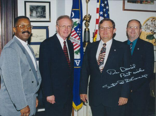 June 4, 1998: FSE was recognized by the SBA as the 1998 National Prime Contractor of the Year. Photo taken in the Office ofSenator Paul Coverdell (Washington, D.C.). From left: Darwin Parker, Senator Coverdell, Dan Tarkington, Dave Ruehlman