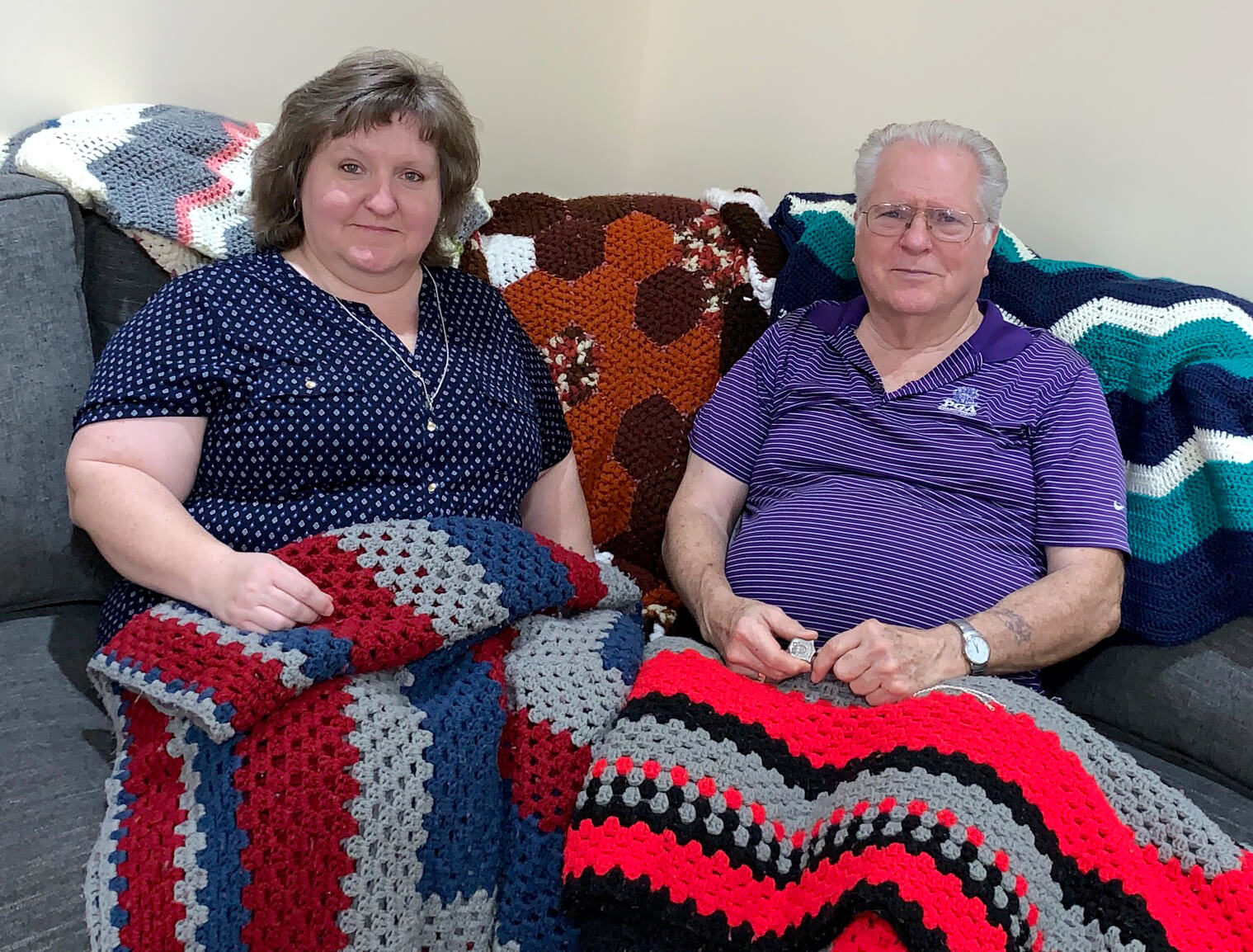 Dana Fisher and her dad with their crocheted blankets